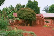 House built of red clay near Jinja, Uganda